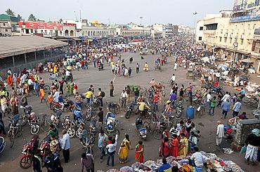 Puri town centre showing busy main street, shops and marketplace near Jagannath Temple to Lord Vishnu, Puri, Odisha, India, Asia