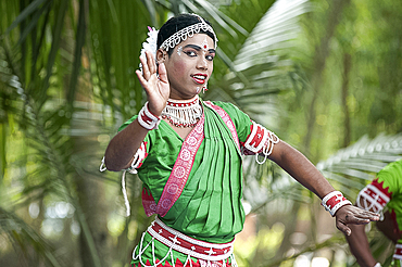 Young boy performing Gotipua dance, the traditional folk dance of Odisha inspired by Hindu gods, Lords Jagannath and Krishna, Odisha, India, Asia