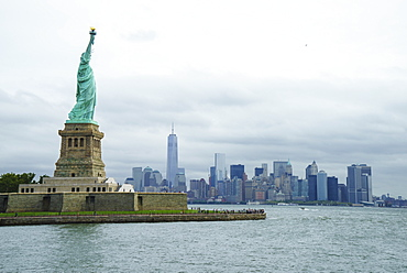 Statue of Liberty with the Lower Manhattan skyline and One World Trade Center beyond, New York City, New York, United States of America, North America