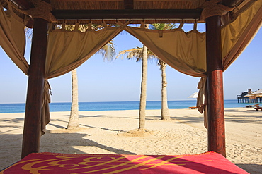 Four poster sunlounger on Jumeirah Beach and the Burj Al Arab Hotel, Jumeirah Beach, Dubai, United Arab Emirates, Middle East