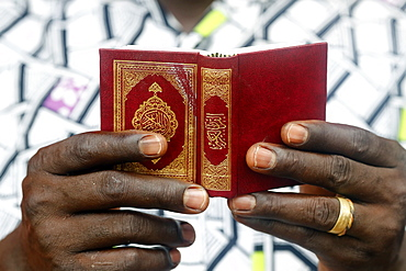 African Muslim man reading the Quran, Lome, Togo, West Africa, Africa