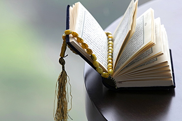 An open Holy Quran and Muslim prayer beads, Ho Chi Minh City, Vietnam, Indochina, Southeast Asia, Asia