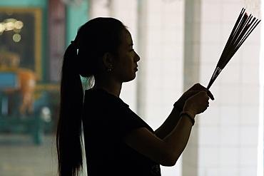 Hindu woman praying with incense sticks, Puja, Sri Thenday Yutthapani Temple, Ho Chi Minh City, Vietnam, Indochina, Southeast Asia, Asia