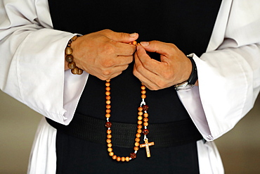 Close-up of monk's hands praying the Rosary, Cistercian Abbey, Our Lady of My Ca, Vietnam, Indochina, Southeast Asia, Asia
