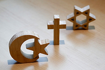 Christianity, Islam, Judaism, the three monotheistic religions in symbols of Jewish Star, Christian Cross and Islamic Crescent, France, Europe