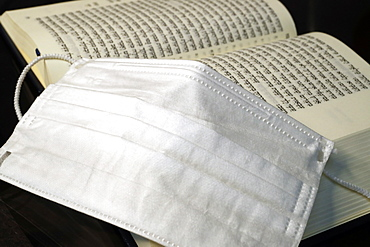 Religion and coronavirus (COVID-19), Torah and disposable surgical mask, Haute-Savoie, France, Europe