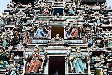 Hindu gods adorn the five storey Raja Gopuram, Sri Mahamariamman Hindu Temple, Kuala Lumpur. Malaysia, Southeast Asia, Asia