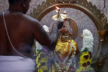 Hindu priest doing puja worship, Durga, Hindu Goddess of War, Sri Mahamariamman Hindu Temple, Kuala Lumpur. Malaysia, Southeast Asia, Asia