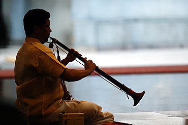 Musician playing a Nadaswaram, a tradional Indian wind instrument, Sri Mahamariamman Hindu Temple, Kuala Lumpur. Malaysia, Southeast Asia, Asia