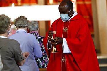 Coronavirus epidemic (Covid-19), Celebration of the Pentecost Mass after lockdown, Holy Communion, Saint Louis de Novel Church, Annecy, Haute Savoie, France, Europe