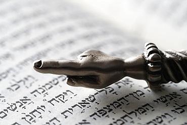 A silver Yad Jewish ritual pointer on a Torah, France, Europe
