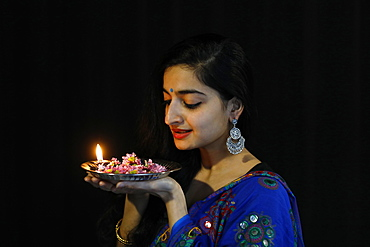 Indian dancer holding a Diwali tray, Paris, France, Europe