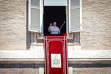 Pope Francis delivers his blessing during the Regina Coeli from the window of his private studio, Vatican, Rome, Lazio, Italy, Europe