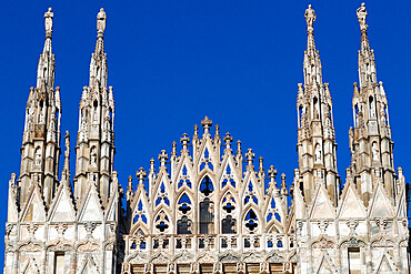 Milan Cathedral. The west facade of the Duomo. The Gothic style cathedral is dedicated to St Mary. Italy.
