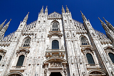 The west facade of the Duomo, the Gothic style cathedral dedicated to St. Mary, Milan, Lombardy, Italy, Europe