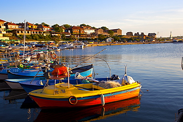 Fishing boats and view towards ramparts and ruins of the medieval fortification walls, Nessebar, Black Sea, Bulgaria, Europe