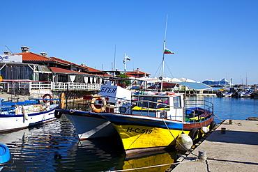 Boats and restaurants along the harbour quay, Nessebar, Black Sea, Bulgaria, Europe