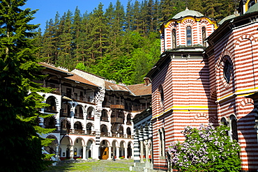 Courtyard, dormitories and Church of the Nativity, Rila Monastery, UNESCO World Heritage Site, nestled in the Rila Mountains, Bulgaria, Europe