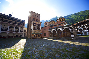 Courtyard, Church of the Nativity and Hrelyo's Tower, Rila Monastery, UNESCO World Heritage Site, nestled in the Rila Mountains, Bulgaria, Europe