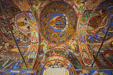 Arcade murals depicting religious figures and scenes, Church of the Nativity, Rila Monastery, UNESCO World Heritage Site, Bulgaria, Europe