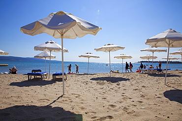 People enjoying the beach and sunshades, South Sunny Beach, Black Sea Coast, Bulgaria, Europe