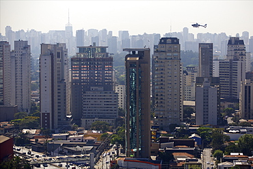 View over skyscrapers, traffic jam and helicopter in Sao Paulo, Brazil, South America