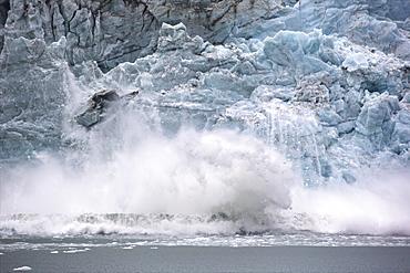 Ice falling from Glacier Pia, Tierra del Fuego, Chile, South America