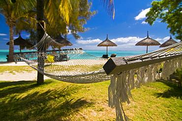Hammock on the beach of the Beachcomber Le Paradis Hotel, Mauritius, Indian Ocean, Africa