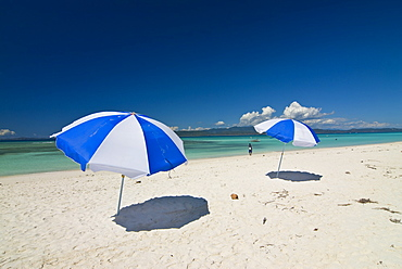 Parasols at the beautiful beach in Nosy Iranja, a little island near Nosy Be, Madagascar, Indian Ocean, Africa