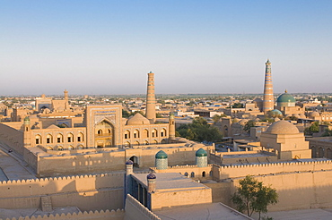 Overlooking city, the Mosques and medressas at Ichon Qala Fortress, Khiva, Uzbekistan, Central Asia