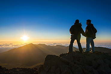 Tourists in backlight waiting for sunset. Haleakala National Park, Maui, Hawaii, United States of America, Pacific