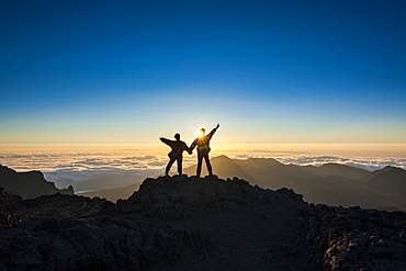 Tourists in backlight waiting for sunset, Haleakala National Park, Maui, Hawaii, United States of America, Pacific