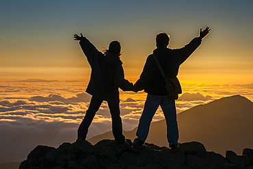 Tourists in backlight waiting for sunset on top of Haleakala National Park, Maui, Hawaii, United States of America, Pacific
