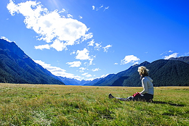 Tourist enjoying Eglinton Valley before the Milford Sound, South Island, New Zealand, Pacific