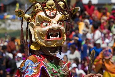 Masked dancer at religious festival with many visitors, Paro Tsechu, Paro, Bhutan, Asia