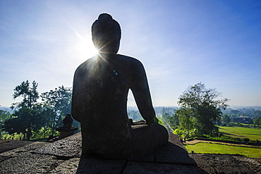 Backlight of a sitting Buddha in the temple complex of Borobodur, UNESCO World Heritage Site, Java, Indonesia, Southeast Asia, Asia