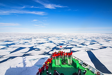 Expedition boat navigating through the pack ice in the Arctic shelf, Svalbard, Arctic