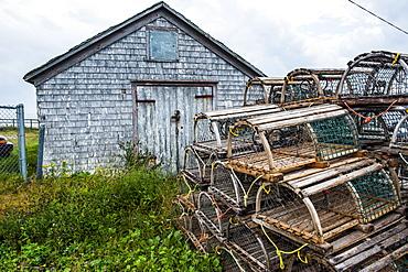 Fish traps in front of a shingle hut in Neils Harbour, Cape Breton Highlands National Park, Cape Breton Island, Nova Scotia, Canada, North America
