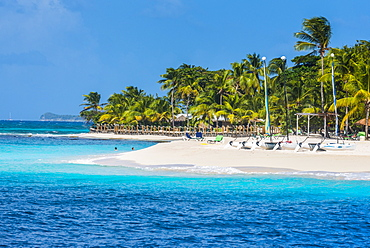 Catamarans on a beautiful palm fringed white sand beach on Palm Island, The Grenadines, St. Vincent and the Grenadines, Windward Islands, West Indies, Caribbean, Central America