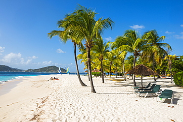 Palm fringed white sand beach on Palm Island with Union Island in the background, the Grenadines, St. Vincent and the Grenadines, Windward Islands, West Indies, Caribbean, Central America