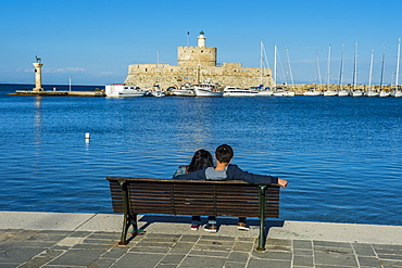 The old Agios Nikolaos fortress and lighthouse in Mandraki Harbour, Rhodes Town, Rhodes, Dodecanese Islands, Greek Islands, Greece, Europe