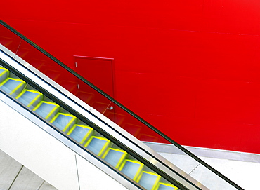Escalator against a red painted wall, Houston, Texas, United States of America, North America