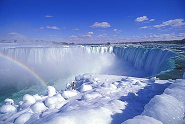 Horseshoe Falls in winter with rainbow, Niagara Falls, Ontario, Canada, North America