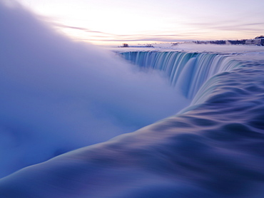 Brink of the Canadian Falls at sunrise in winter, Niagara Falls, Ontario, Canada, North America