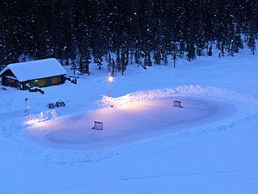 Ice hockey rink on frozen Lake Louise, Banff National Park, Alberta, Canada, North America