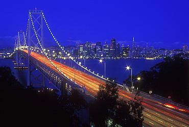 Oakland Bay Bridge illuminated at dusk with traffic streaks, San Francisco, California, United States of America, North America