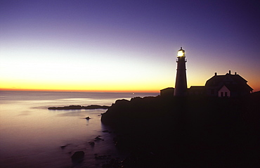 View of Portland Head Lighthouse and lighthouse keepers house at dawn, Cape Elizabeth, Maine, New England, United States of America, North America
