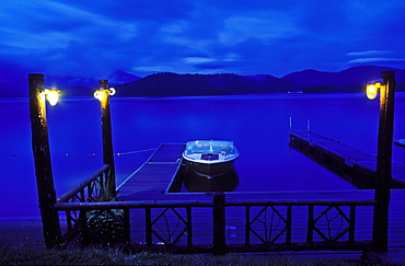 Boat moored at a dock at twilight, Lake Placid, New York State, United States of America, North America