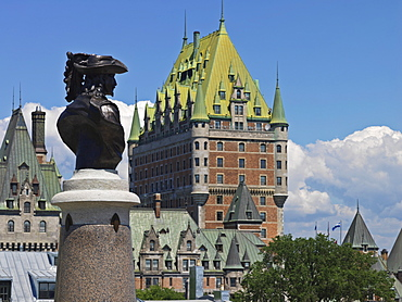 Statue of Pierre du Gua de Monts, co-founder of Quebec City and a view of Chateau Frontenac hotel, UNESCO World Heritage Site, Quebec City, Quebec, Canada, North America