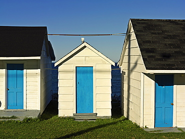Motel units with brightly colored blue doors, L'Anse-a-Valleau, Gaspesie, Quebec, Canada, North America